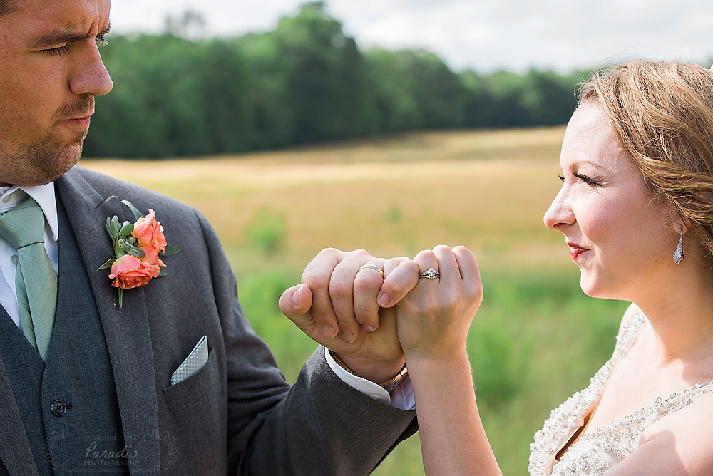 pinky promise rings on bride and groom at maine weddings