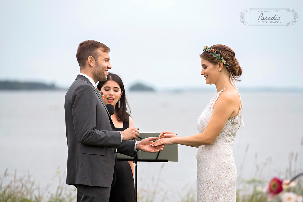 exchanging rings at maine wedding ceremony
