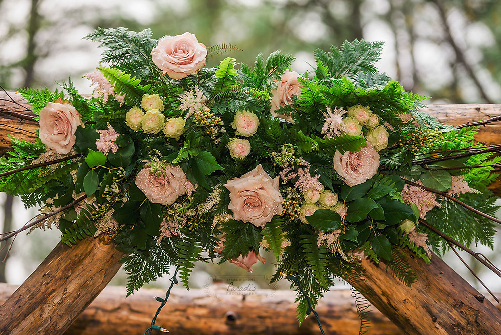 floral arrangement on arbor at maine wedding