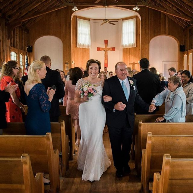 happy bride and groom at st brendan's chapel in bidderford maine