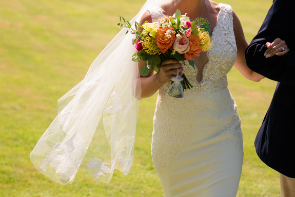 bride walking down the aisle in diamond cove maine