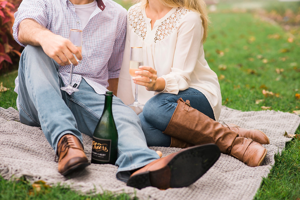 cheers champagne picnic for engagement session in portsmouth nh