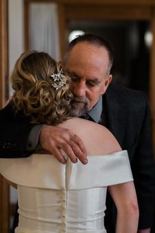 Hugging wedding guest