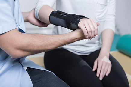Occupational therapist treating hand wrist injury