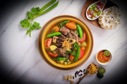 Lamb in oxtail soup broth