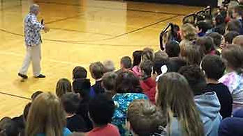 Kevin Wanzer presenting a school assembly