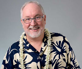 Kevin Wanzer headshot with hawaiian shirt