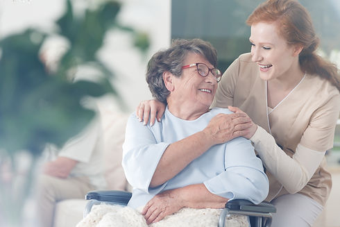 Happy patient is holding caregiver for a
