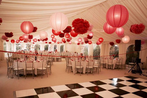Red and pink lanterns and giant pompoms