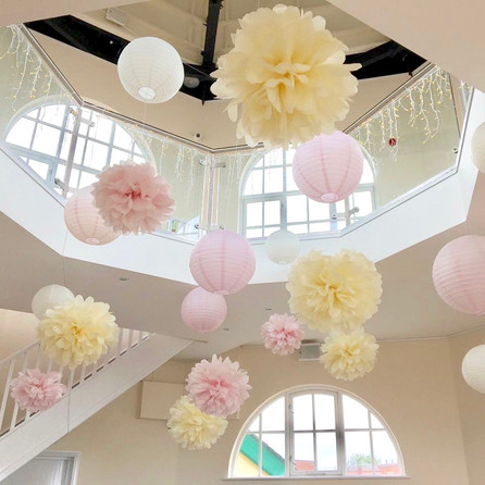 Vintage style paper lantern and pompom installation at The Dome, Worthing