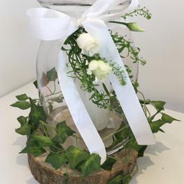 Glass lanterns, vases and jars