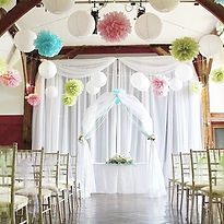 Paper lanterns and tissue pompoms at Northease Manor