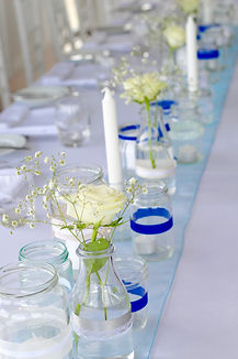 Wedding tablescape miss-matched bottles and bud vases