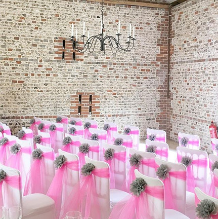 Pink chair veils with dove grey pompoms
