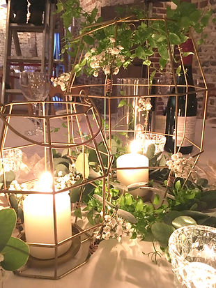 Geometric lanterns styled with greenery