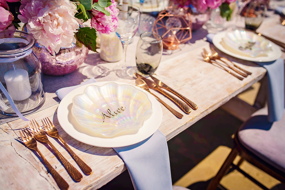 Mermaid party plates, rose gold cutlery and copper tablescape