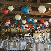 Red white and blue pape lanterns at Laughton Barns wedding venue