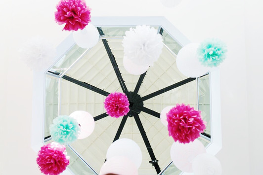 Paper lanterns and tissue pompoms