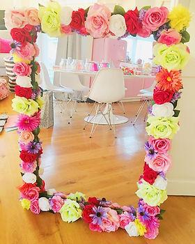 Unusual wedding table plan ideas - bright flower mirror for hire