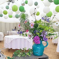 Green and white paper lantens at marquee wedding