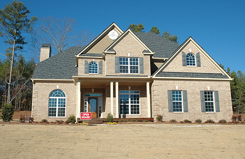 canva-brown-and-gray-house-placed-near-f