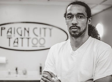 KK Paign City Tattoo Owner/Tattoo Artist