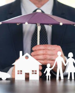 Concept of insurance with umbrella over
