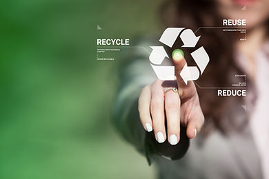 Businesswoman touching recycling symbol