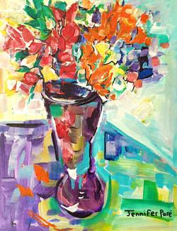 Purple vase of flowers