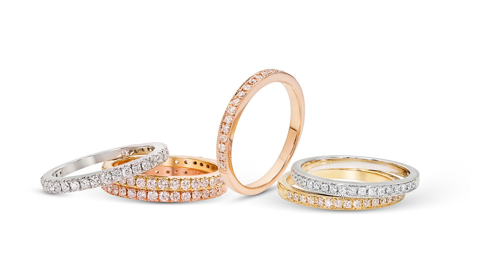 A photo of diamond engagement rings in white gold, yellow gold, and rose gold
