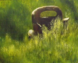 old pickup in tall summer grass