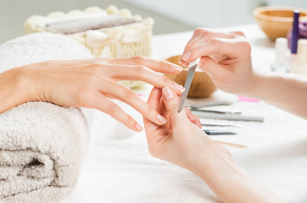 Closeup shot of a woman in a nail salon