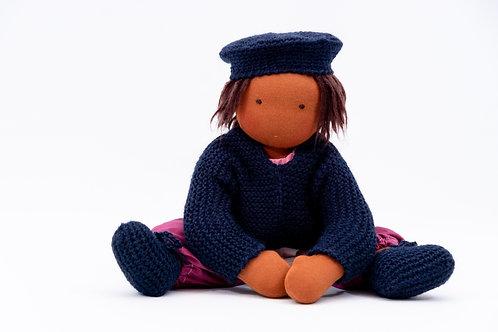Waldorfpuppe und handgefertigte Puppenkleidung