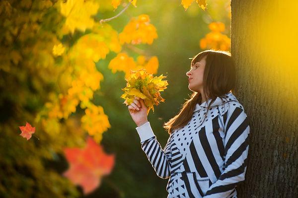 Canva - Woman Holding Leaves.jpg