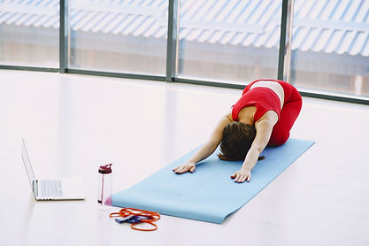 Canva - Young woman performing yoga exer