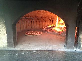 traditona pizza oven, fire, logs, pizza, bricks