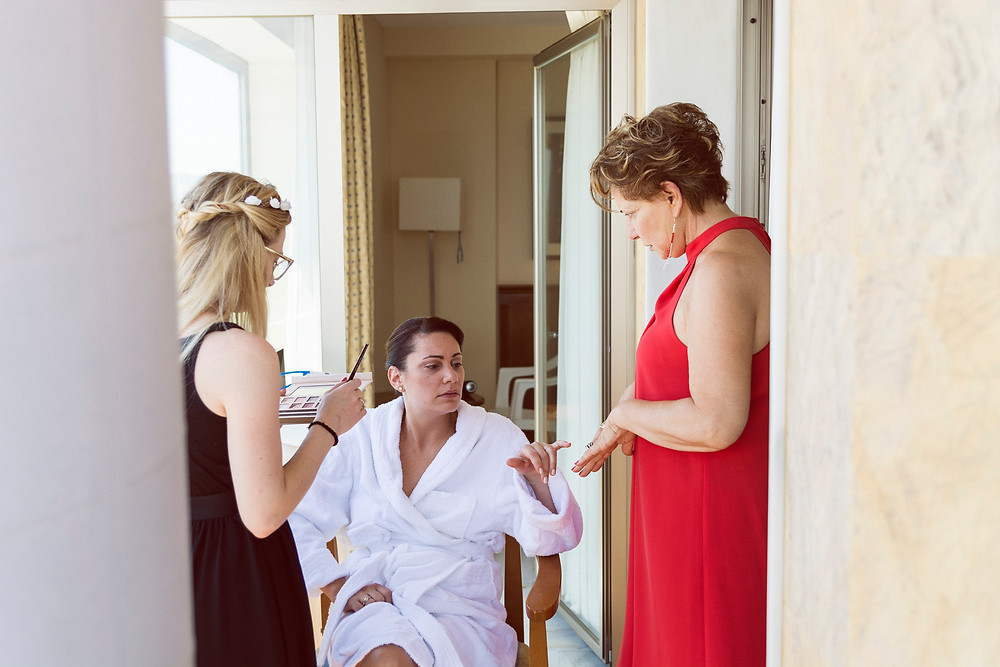the bride and her family in a hotel before the ceremony