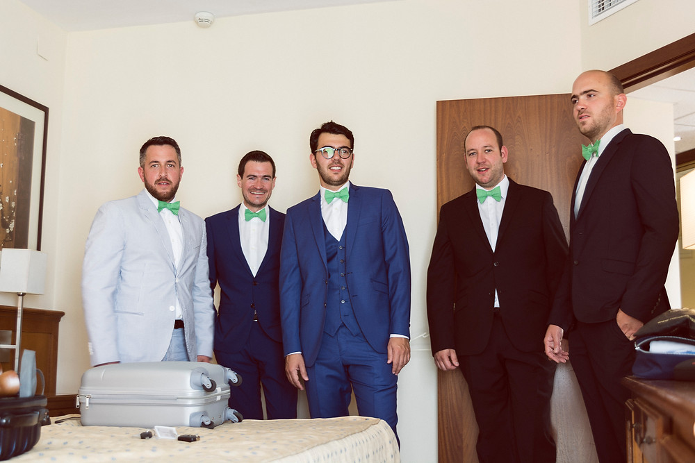 the groom and friends getting ready for the wedding