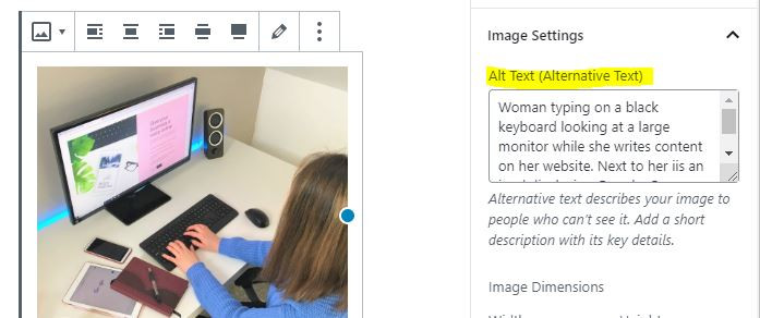 Screenshot of Wordpress alt tag formatting showing a woman creating a website alongside alt text about the woman for SEO purposes