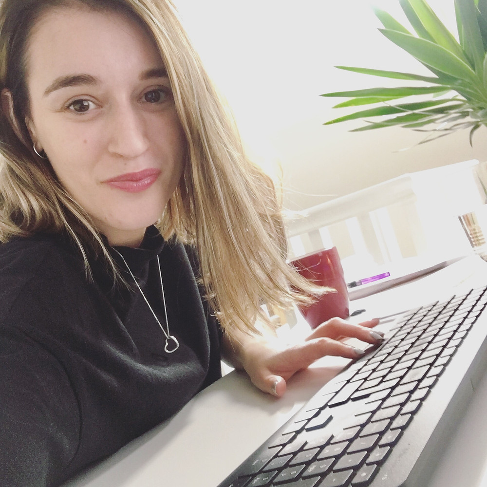 Zo Connected Marketing Consultant in Cheshire at her desk discussing content marketing