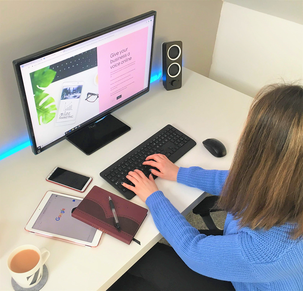 Freelancer Zo Connected sat at desk planning to write a blog for Cheshire small businesses
