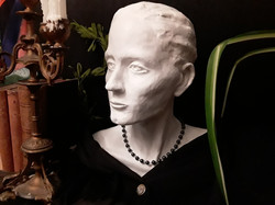 Vignette with bust and books