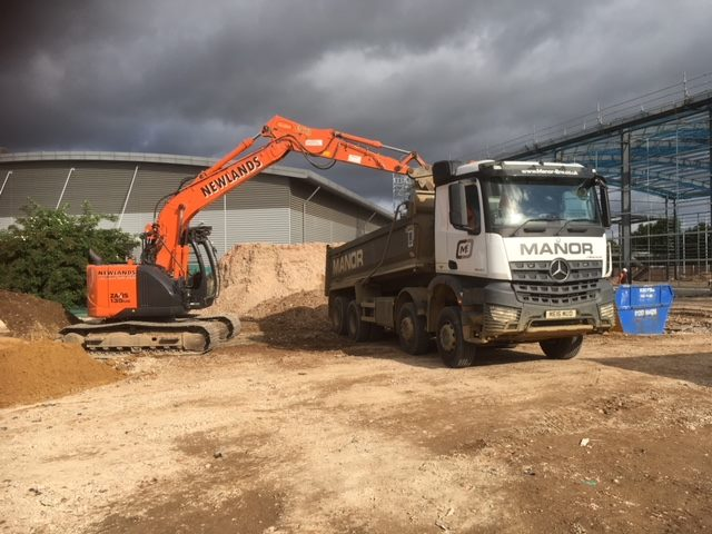 Building site muck being loaded