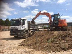 Arocs tipper being loaded with muck