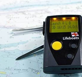34346-RNLI-pager-on-a-chart-with-a-pair-