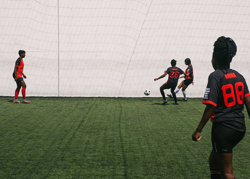 women-playing-in-football-on-grass-filed