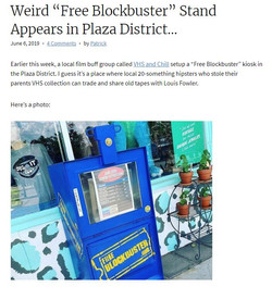 Weird 'Free Blockbuster' Stand Appears in Plaza District…
