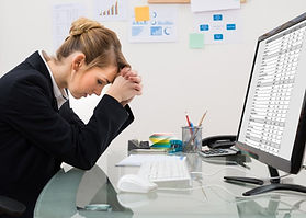 stressed-businesswoman-in-office-picture