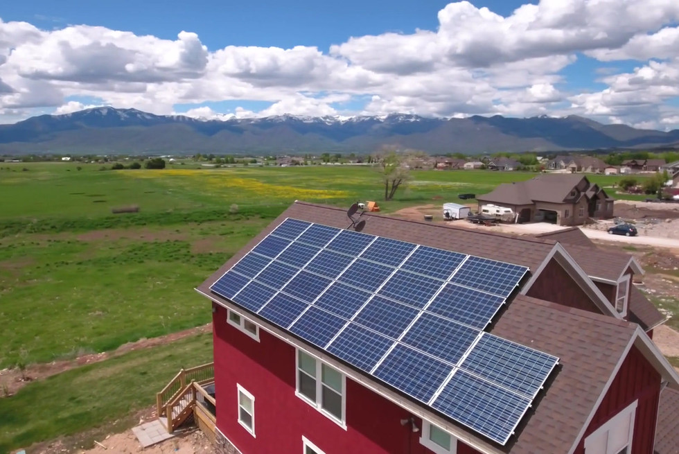 aerial-shot-of-flying-over-house-with-solar-panels-in-spring_hdfby2zq_1080__D.mp4