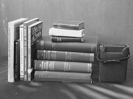A group of secondhand books on a shelf